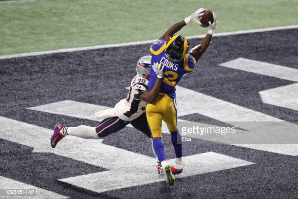 Brandin Cooks of the Los Angeles Rams drops a pass in the endzone as he is defended by Jason McCourty of the New England Patriots in the second half...