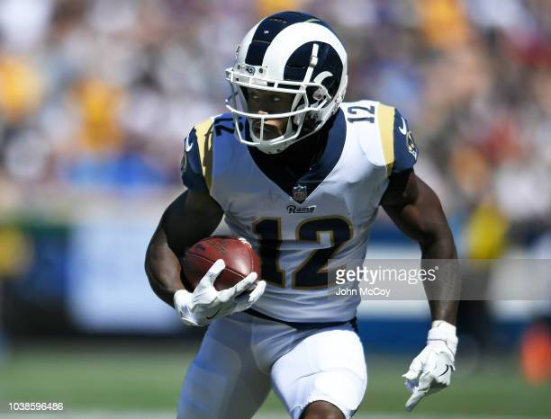 Brandin Cooks of the Los Angeles Rams runs the ball against the Arizona Cardinals at Los Angeles Memorial Coliseum on September 16 2018 in Los...