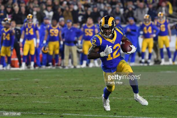 Brandin Cooks of the Los Angeles Rams runs with the ball in the fourth quarter against the Dallas Cowboys in the NFC Divisional Playoff game at Los...