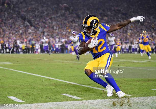 Brandin Cooks of the Los Angeles Rams tip toes along the sidelines after his catch during the fourth quarter of a 3831 victory over the Minnesota...