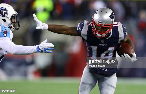 Brandin Cooks of the New England Patriots carries the ball after a catch as he is defended by Adoree' Jackson of the Tennessee Titans in the second...