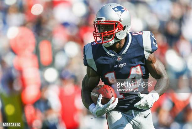 Brandin Cooks of the New England Patriots carries the ball for a touchdown during the third quarter of a game against the Houston Texans at Gillette...