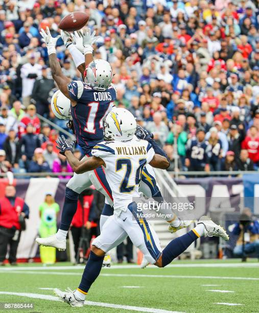 Brandin Cooks of the New England Patriots catches a pass as he is defended by Trevor Williams of the Los Angeles Chargers during the second quarter...