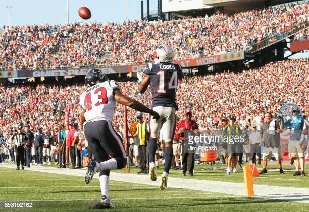 Brandin Cooks of the New England Patriots catches the game winning touchdown as he is defended by Corey Moore of the Houston Texans during the fourth...