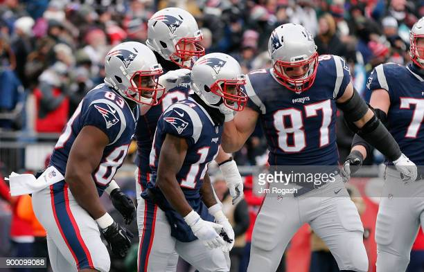 Brandin Cooks of the New England Patriots celebrates with teammates after scoring a touchdown during the second quarter against the New York Jets at...