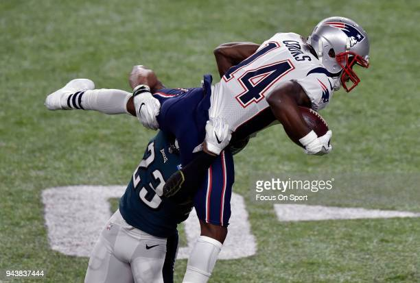 Brandin Cooks of the New England Patriots gets tackled by Rodney McLeod of the Philadelphia Eagles during Super Bowl LII at US Bank Stadium on...