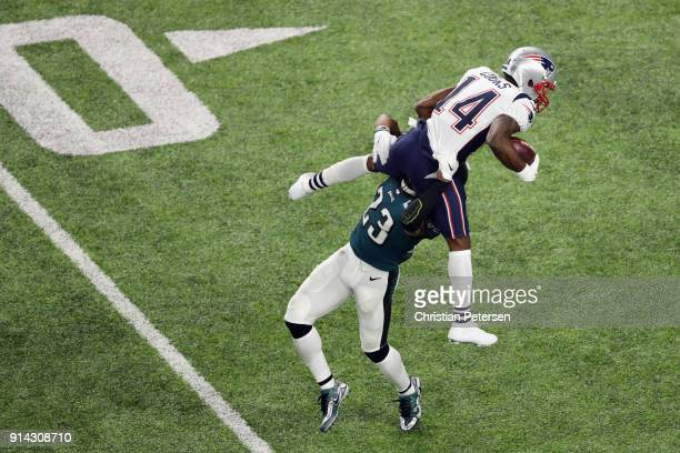 Brandin Cooks of the New England Patriots is stopped by Rodney McLeod of the Philadelphia Eagles as he attempts to leap over the tackle try during...