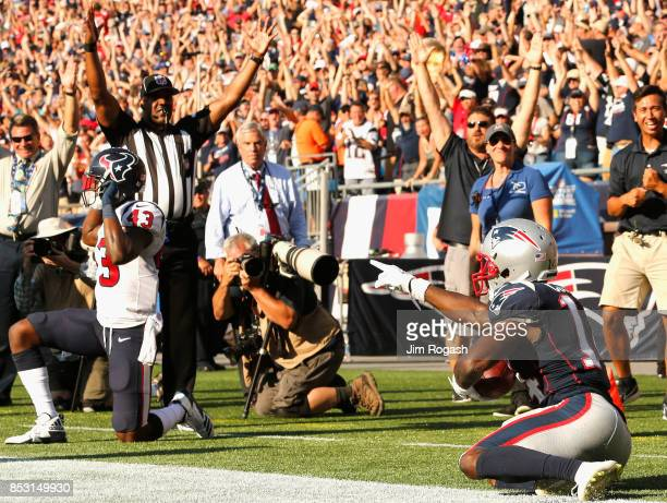 Brandin Cooks of the New England Patriots reacts after catching the game winning touchdown as he is defended by Corey Moore of the Houston Texans...