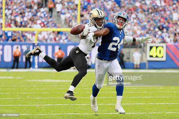 Brandin Cooks of the New Orleans Saints attempts to catch the ball against Eli Apple of the New York Giants during the second half at MetLife Stadium...