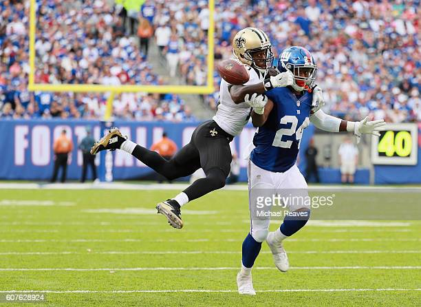 Brandin Cooks of the New Orleans Saints attempts to make a catch against Eli Apple of the New York Giants during the second half at MetLife Stadium...