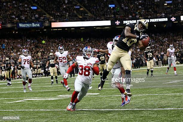 Brandin Cooks of the New Orleans Saints catches a pass for a touchdown during the third quarter of a game against the New York Giants at the...