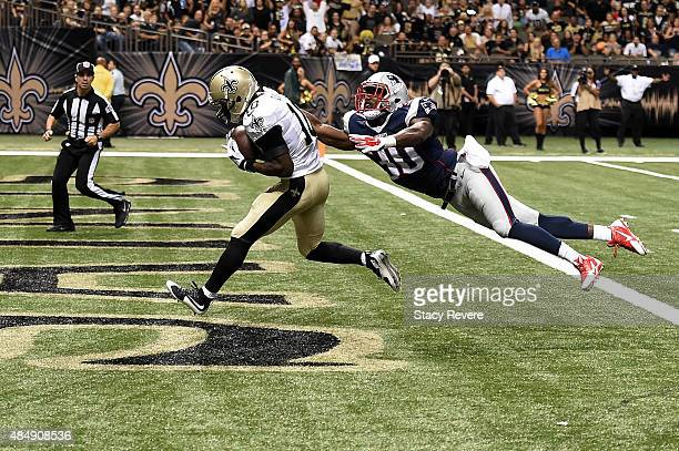 Brandin Cooks of the New Orleans Saints catches a pass for a touchdown in front of Duron Harmon of the New England Patriots during the first quarter...