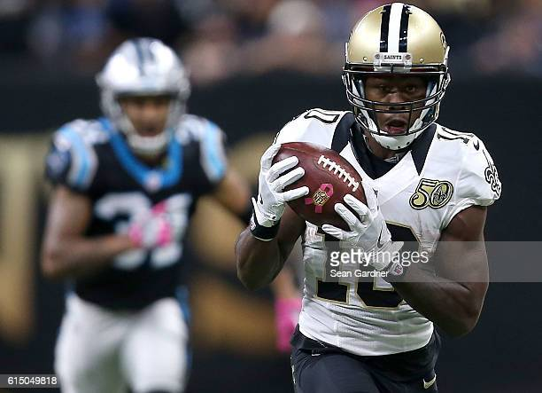 Brandin Cooks of the New Orleans Saints catches the ball for a first down against the Carolina Panthers during the fourth quarter at the MercedesBenz...