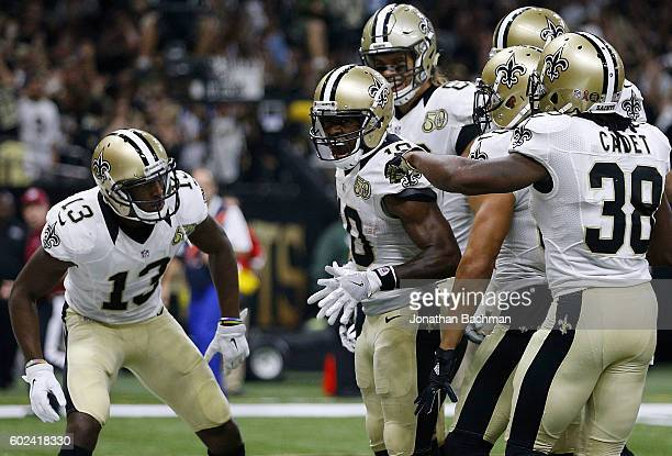 Brandin Cooks of the New Orleans Saints celebrates a touchdown during the first half of a game against the Oakland Raiders at MercedesBenz Superdome...