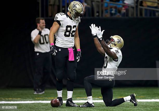 Brandin Cooks of the New Orleans Saints celebrates with Coby Fleener after scoring a touchdown against the Carolina Panthers during the first quarter...