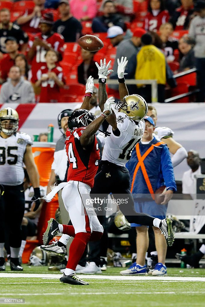 Brandin Cooks #10 of the New Orleans Saints fails to pull in a reception against Brian Poole #34 of the Atlanta Falcons during the second half at the Georgia Dome on January 1, 2017 in Atlanta, Georgia.