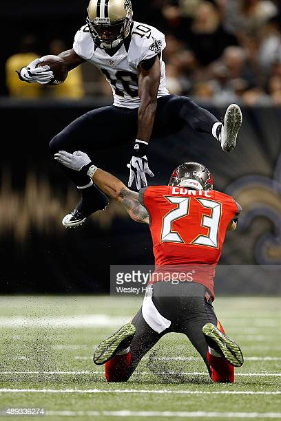 Brandin Cooks of the New Orleans Saints leaps over Chris Conte of the Tampa Bay Buccaneers during the fourth quarter of a game at the MercedesBenz...