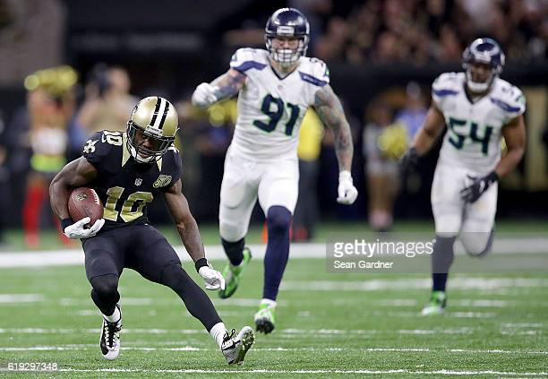 Brandin Cooks of the New Orleans Saints runs for a first down against the Seattle Seahawks during the third quarter at the Mercedes-Benz Superdome on...