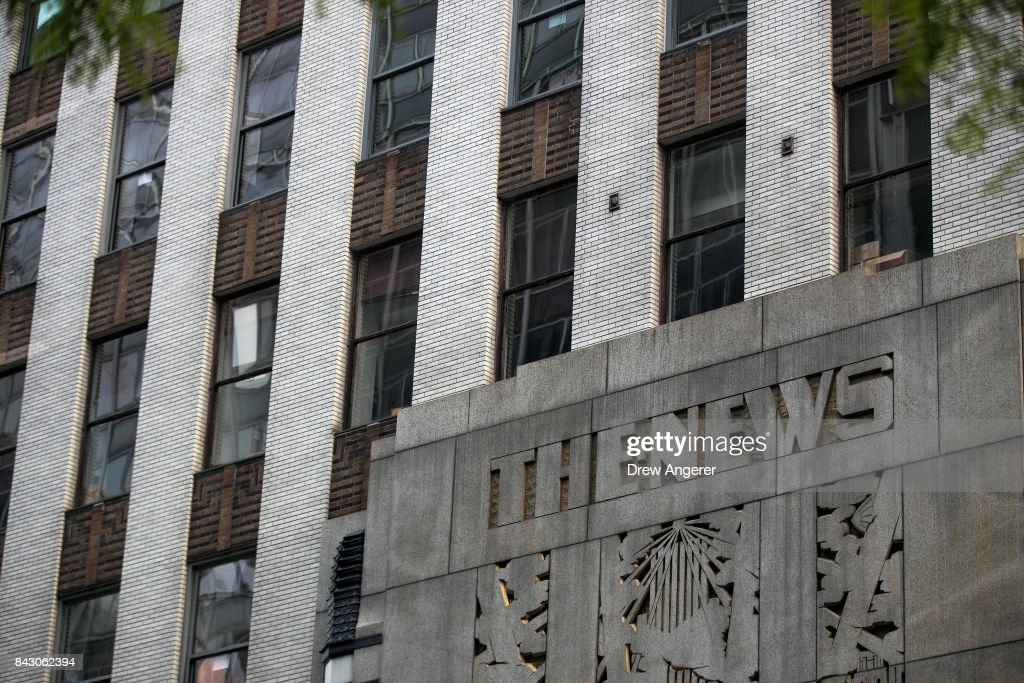 Branding For The New York Daily News Is Displayed On The Facade Of
