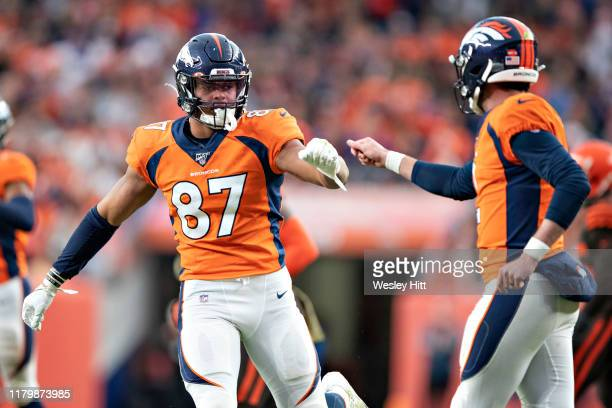 Brandon Allen is congratulated by Noah Fans of the Denver Broncos after a touchdown during the second half of a game against the Cleveland Browns at...