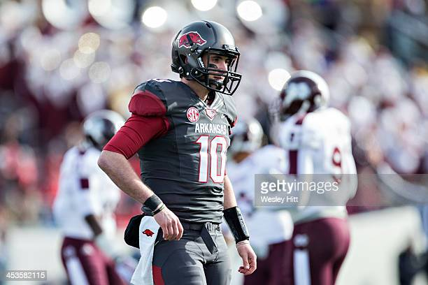 Brandon Allen of the Arkansas Razorbacks congratulates teammates looks toward the sidelines during a game against the Mississippi State Bulldogs at...