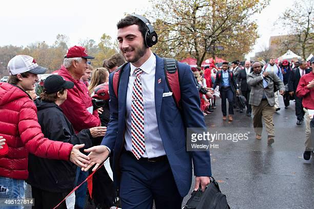 Brandon Allen of the Arkansas Razorbacks greets fans during the walk into the stadium before a game against the UT Martin Skyhawks at Razorback...
