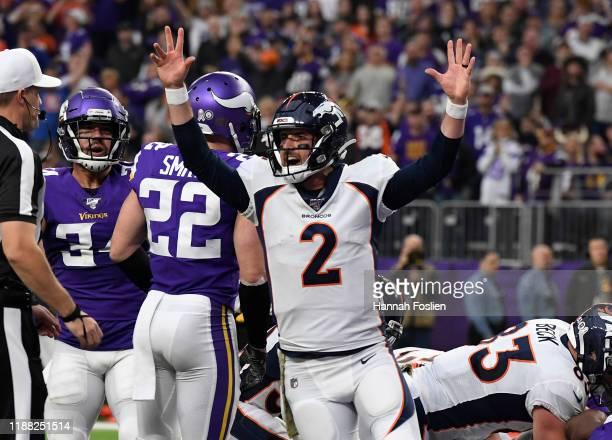 Brandon Allen of the Denver Broncos celebrates a touchdown against the Minnesota Vikings in the second quarter at US Bank Stadium on November 17 2019...