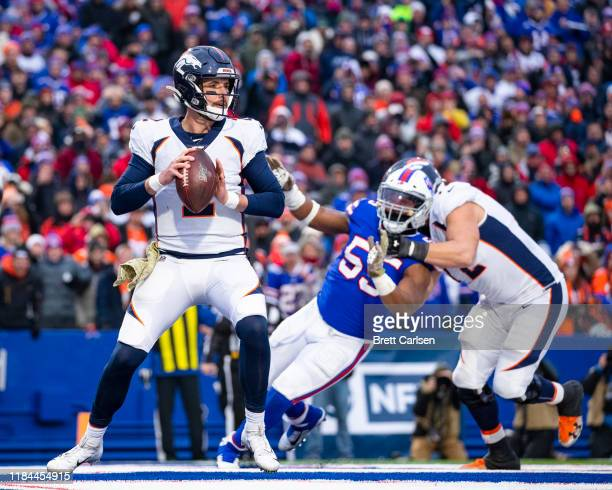 Brandon Allen of the Denver Broncos drops back to pass in his own end zone during the fourth quarter against the Buffalo Bills at New Era Field on...