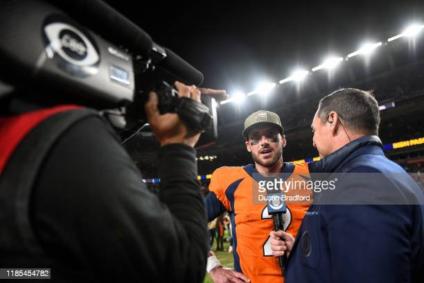 Brandon Allen of the Denver Broncos gives an interview on the field after a 2419 win in his NFL debut against the Cleveland Browns at Empower Field...