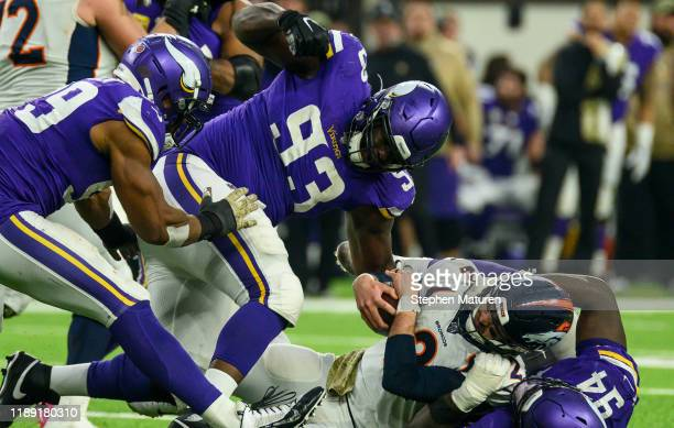 Brandon Allen of the Denver Broncos is sacked by Jaleel Johnson of the Minnesota Vikings in the fourth quarter of the game at US Bank Stadium on...