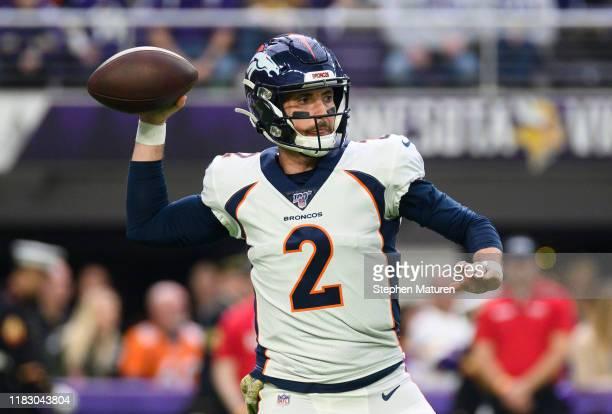 Brandon Allen of the Denver Broncos passes the ball in the first quarter of the game against the Minnesota Vikings at US Bank Stadium on November 17...