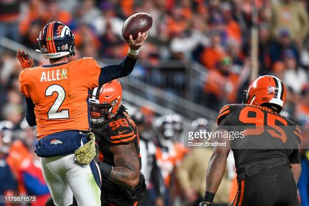 Brandon Allen of the Denver Broncos passes under pressure by Sheldon Richardson of the Cleveland Browns at Empower Field at Mile High on November 3...