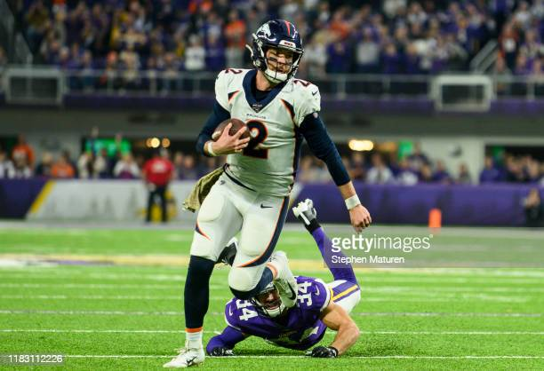 Brandon Allen of the Denver Broncos runs with the ball in the fourth quarter of the game against the Minnesota Vikings at US Bank Stadium on November...