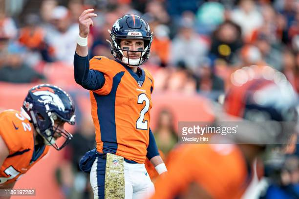 Brandon Allen of the Denver Broncos signals at the line of scrimmage during a game against the Cleveland Browns at Broncos Stadium at Mile High on...