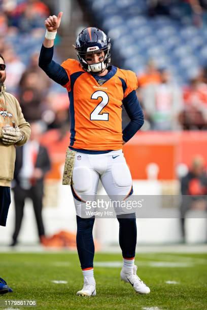Brandon Allen of the Denver Broncos signals before a game against the Cleveland Browns at Broncos Stadium at Mile High on November 3 2019 in Denver...