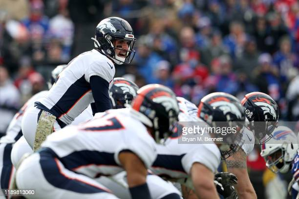 Brandon Allen of the Denver Broncos signals during the first quarter of an NFL game against the Buffalo Bills at New Era Field on November 24 2019 in...