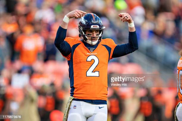 Brandon Allen of the Denver Broncos signals to the sidelines for a play during the second half of a game against the Cleveland Browns at Broncos...