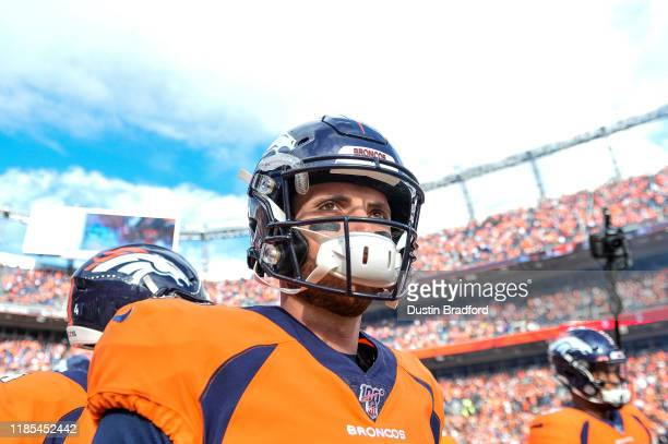 Brandon Allen of the Denver Broncos stands on the field during starting defense introductions before a game against the Cleveland Browns at Empower...