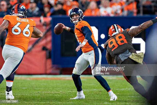 Brandon Allen of the Denver Broncos throws a pass under pressure during the second half of a game against the Cleveland Browns at Broncos Stadium at...