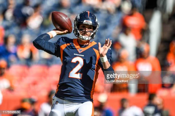 Brandon Allen of the Denver Broncos throws as he warms up before a game against the Tennessee Titans at Empower Field at Mile High on October 13 2019...