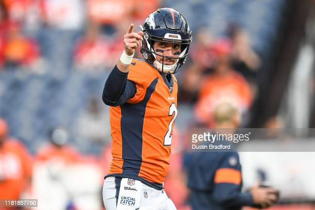 Brandon Allen of the Denver Broncos warms up before a game against the Kansas City Chiefs at Empower Field at Mile High on October 17 2019 in Denver...