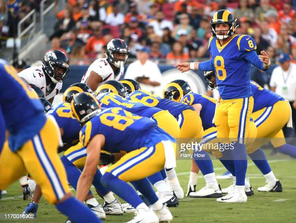 Brandon Allen of the Los Angeles Rams calls a play at the line of scrimmages during the first quarter of a preseason game at Los Angeles Memorial...