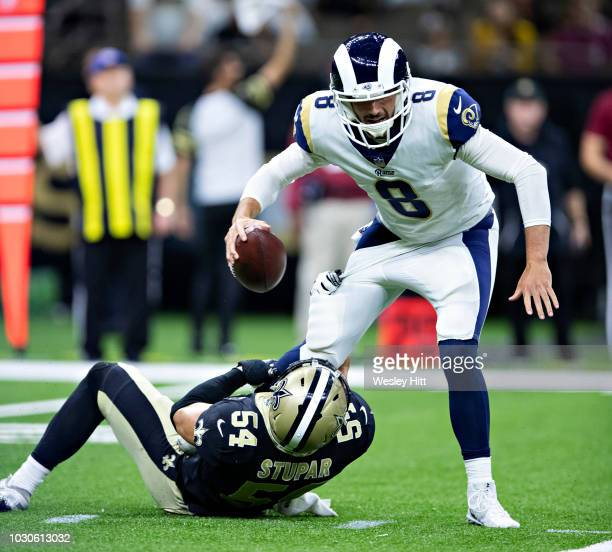 Brandon Allen of the Los Angeles Rams is sacked by Nate Stupar of the New Orleans Saints at MercedesBenz Superdome during week 4 of the preseason on...