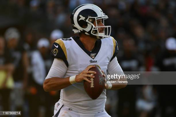 Brandon Allen of the Los Angeles Rams looks to pass against the Oakland Raiders during their NFL preseason game at RingCentral Coliseum on August 10...