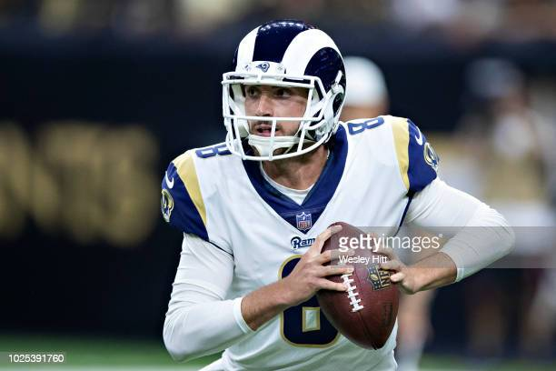 Brandon Allen of the Los Angeles Rams rolls out looking for a receiver during a game against the New Orleans Saints at MercedesBenz Superdome during...