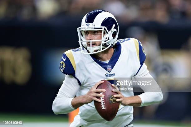 Brandon Allen of the Los Angeles Rams rolls out to pass during a game against the New Orleans Saints at MercedesBenz Superdome during week 4 of the...