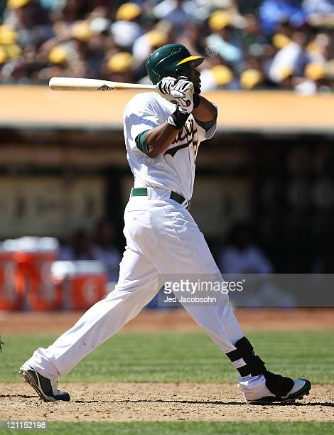 Brandon Allen of the Oakland Athletics hits an RBI double against the Texas Rangers at Oco Coliseum on August 14 2011 in Oakland California