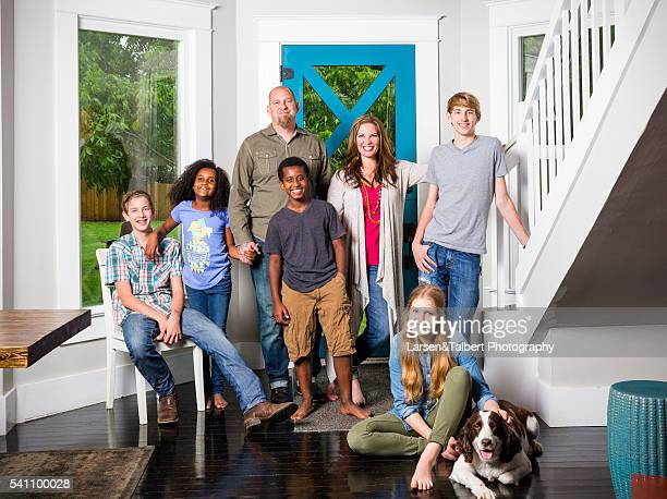 Brandon and Jen Hatmaker at home in Buda TX with Gavin Sydney Beth Caleb Ben Remy and Ladybird the dog
