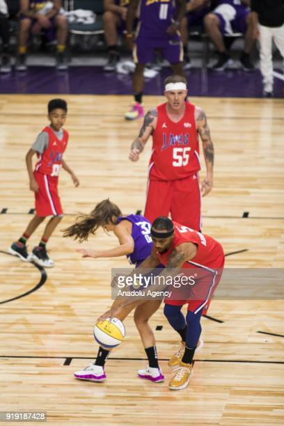 Brandon Armstrong of Team Clippers steals the ball from Rachel DeMita of Team Lakers during the 2018 NBA AllStar Celebrity Game as part of AllStar...