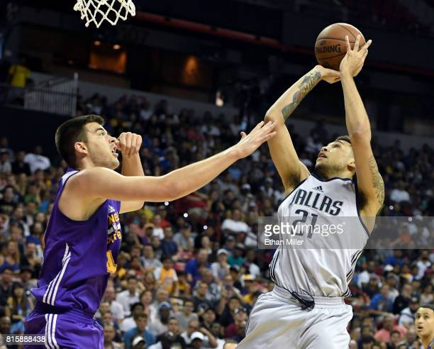 Brandon Ashley of the Dallas Mavericks shoots against Ivica Zubac of the Los Angeles Lakers during a semifinal game of the 2017 Summer League at the...